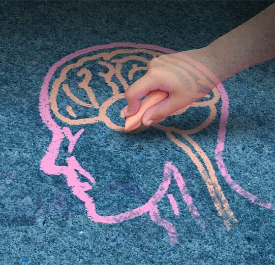 Chalk drawing on pavement of human head and brain