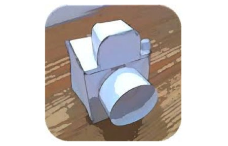Paper camera icon with a paper camera sitting on a table